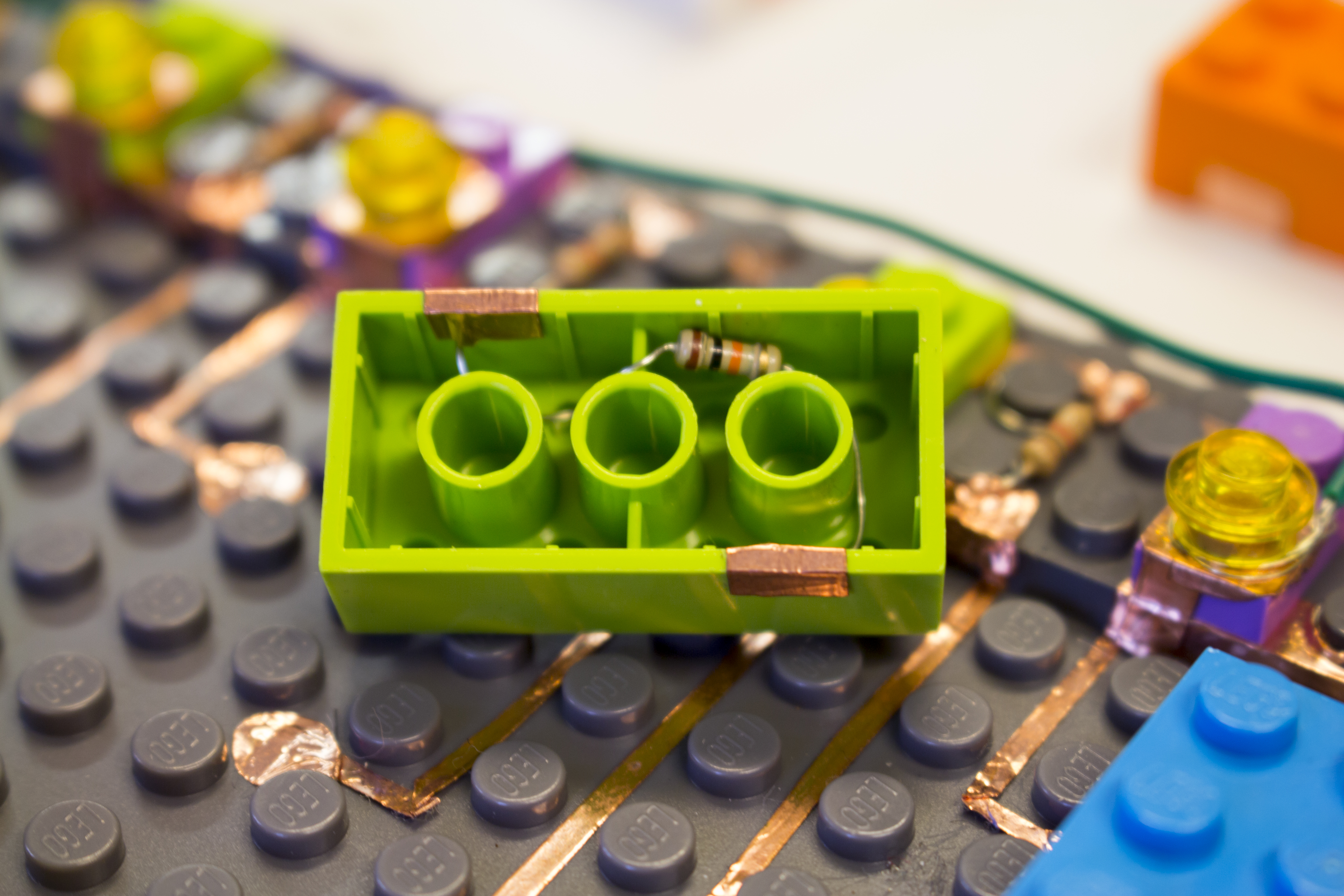 lego circuits \u2013 alemolinai placed resistors inside of the bricks, and, with conductive tape, made the connections i used a different colored brick for each resistor value,